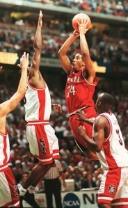 Andre Miller splits Arizona's defense during NCAA upset. photo by Tom Smart