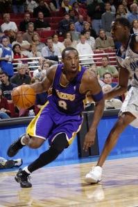 Kobe Bryant around Tracy McGrady
